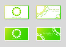 Two vector business card templates with company logo. In green colors Stock Photos