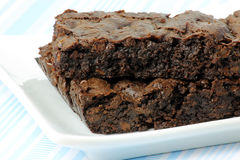 Two Vegan Brownies on a White Plate Royalty Free Stock Photography