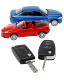 Two vehicle keys close up and model cars Stock Photo
