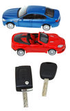 Two vehicle keys close up and model cars Royalty Free Stock Photography
