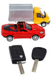 Two vehicle keys and model truck and car Stock Photo