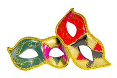 Two Venetian carnival half-mask gold red green black pink asymme. Try pattern isolated white background Stock Photos