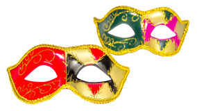 Two Venetian carnival half-mask gold red green black pink asymme. Try pattern isolated white background Royalty Free Stock Image