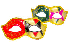Two Venetian carnival half-mask gold red green black pink asymme. Try pattern isolated white background Royalty Free Stock Images