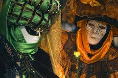 Two venetian mask at Annecy's carnival. Stock Image