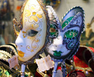 Two venetian masks. Two venetian carnival masks in yellow and green Stock Photo