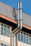 Two ventilation chimneys in stainless steel. Close up of two ventilation chimneys in stainless steel Royalty Free Stock Photo