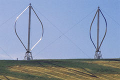 Two vertical-axis wind turbines Stock Photography