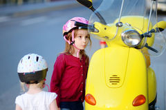 Two very curious little girls and a motorcycle Royalty Free Stock Image