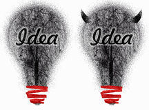 Two very dirty ideas. Two hand drawn with charcoal and red marker light bulbs representing a dirty idea and a very dirty idea Royalty Free Stock Photo