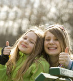 Two very happy grils in a park. Blurry background Stock Image