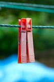Two very old and used clothespins on a rope Royalty Free Stock Photos