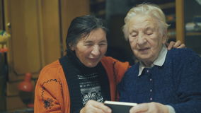 Two very old women speaking on the web chat 4K stock footage