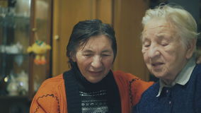 Two very old women speaking on the web chat 4K.  stock video footage