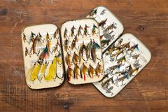 Two opened salmon fly boxes Stock Photo