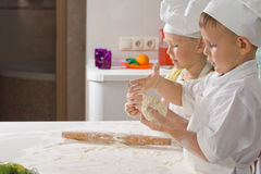 Two Very Young Chefs Preparing for Pizza Royalty Free Stock Photos