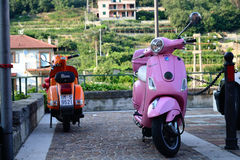 Two Vespa scooter mobiles Royalty Free Stock Photos