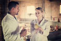 Two veterinarian talking and having duckling Stock Image