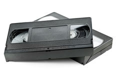 Two video home system movie cassettes. Two analog video home system (VHS) tape over white background Stock Photos