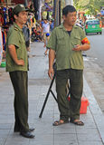 Two vietnamese policemen are watching what happen Royalty Free Stock Photos