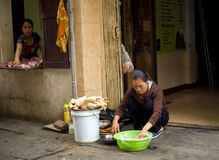 Two Vietnamese women selling meat in Old Quarter of Hanoi, Vietnam Royalty Free Stock Images