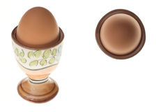 Two views of an egg. In a vintage pot Stock Images