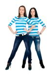 Two vigorous girls in striped vests Royalty Free Stock Image