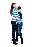 Two vigorous girls in striped vests Royalty Free Stock Images