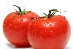 Two vine tomatos macro Royalty Free Stock Photos