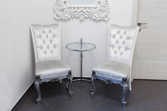 Two vintage armchairs and glass coffe table Royalty Free Stock Photo