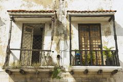 Two vintage balconies in a colonial house in Santo Domingo, Dominican Republic. Stock Images