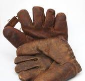 Two vintage baseball gloves stock images