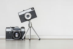 Two vintage cameras together. Big and little concept. Stock Photo