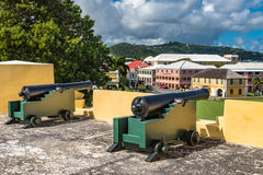 Two vintage cannons on the fort wall facing the town. Royalty Free Stock Photo