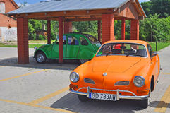 Two vintage cars Volkswagen and Citroen. Vintage German VW Karmann Ghia car built around 1964 and French Citroen 2CV, before rally of retro cars in Tczew, Poland Stock Photography