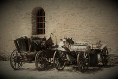 Two vintage carts. Standing near the ancient house Royalty Free Stock Images