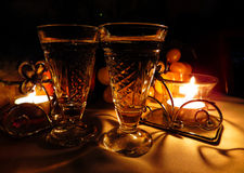 Two vintage champagne wineglass festive evening candle and gentle sweet green grapes. Royalty Free Stock Images