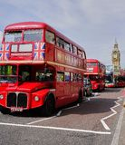 Line of Red Double Decker Buses near Big Ben - London stock image