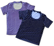 Two vintage cotton t-shirts a pois. Two vintage cotton t-shirts with dot pattern, dark blue and pastel lavender, isolated on white Royalty Free Stock Images