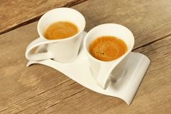 Two Vintage Cups of Espresso on Grungy Wooden Table,  Stock Photo