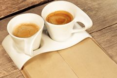Two Vintage Cups of Espresso on Grungy Wooden Table,  Stock Photography
