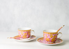 Two vintage cups, sauceres and spoons Royalty Free Stock Photo