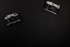 Two vintage film camera on office table. Top view Royalty Free Stock Images