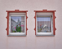 Two vintage framed windows on pink wall Royalty Free Stock Photo