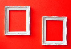 Two vintage frames on red wall Royalty Free Stock Photo