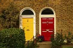 Two vintage Georgian doors yellow and red colors in Dublin, Irela stock images