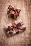 Two vintage gift boxes with brown bows on old Royalty Free Stock Photo