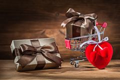 Free Two Vintage Gift Boxes In Shopping Cart And Heart Toy Royalty Free Stock Image - 141548316