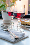 Two vintage glasses of red wine Stock Images