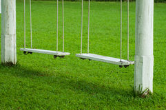 Two vintage hanging swing seats Stock Photos